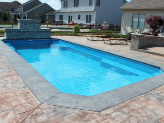 Fiberglass Pool with Stone Walll