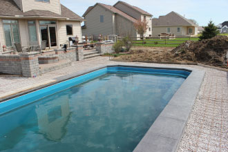 Filled Fiberglass Pool with Concrete Cap