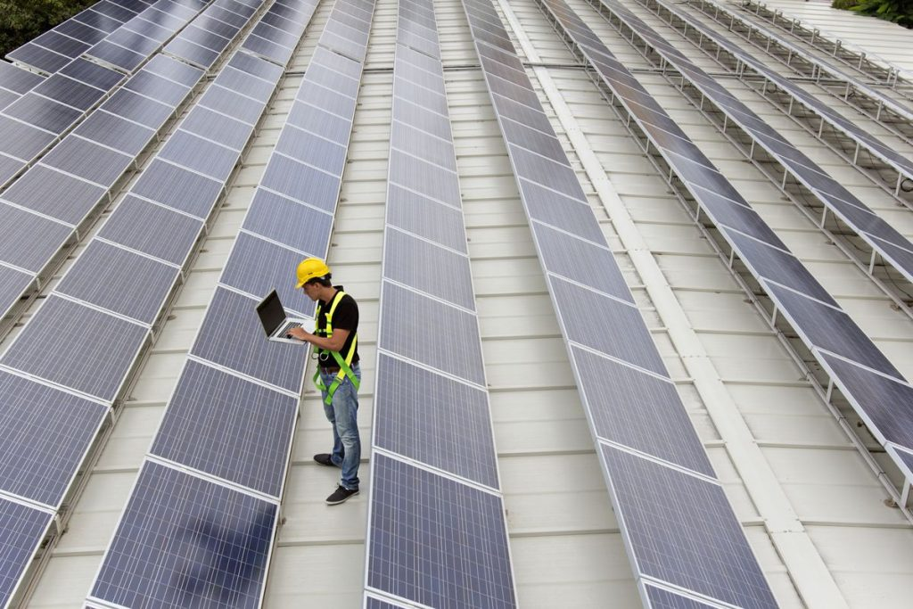 Image of an engineer gathering data in a photovoltaic farm on a roof top (ISO 200). All my images have been processed in 16 Bits and transfer down to 8 before uploading.