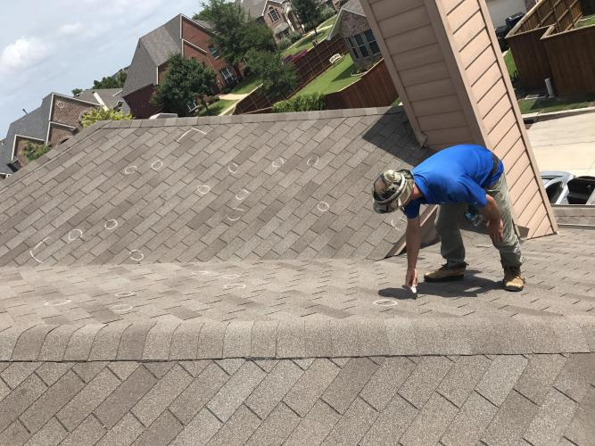 Technician on a Shingle Roof