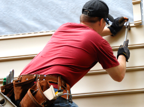 Man Attaching Vinyl Siding