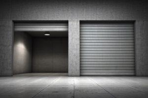 grey garage doors, one open