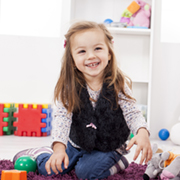 Girl sitting on playmat