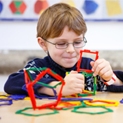 Young boy building 3d objects