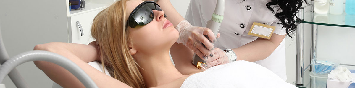 woman getting laser hair removal on her underarms